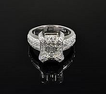 A PLATINUM EMERALD CUT DIAMOND RING WITH BAGUETTES