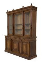 A LATE 19TH CENTURY RENAISSANCE REVIVAL THREE-DOOR STRAIGHT FRONT LIBRARY BOOKCASE