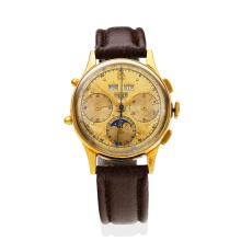 A Gentleman's gold triple calendar chronograph wristwatch, Heuer, circa 1960's. Manual. 35mm. Gold coloured silver dial with black Arabic numerals. Movement Valijoux 72 base. Case number 84429. Movement number 550157. 18ct yellow gold. Dark brown leather strap.ÿ
