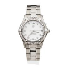 A Lady's stainless steel and diamond Aquaracer, Tag Heuer, circa late 2000's. Quartz. 32mm.ÿRef: WAF1313. Case number NM0604. Mother of pearl dial with diamond markers, diamond bezel. Case, dial, movement and bracelet signed.