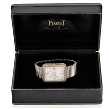 A Gentleman's diamond wristwatch, Piaget,ÿcirca early 1970's. Quartz. 41 x 34mm. Ref: 14105C150. Case number 212970. Pave diamond bezel and dial with sapphire makers at quarters.ÿCase, movement and integral bracelet signed. Original box and six extra links. Total weight 225 grams. Length 18.5cm. To be sold with the book
