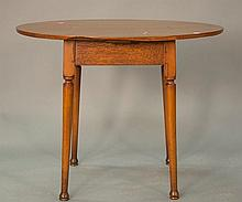 Queen Anne tea table having oval top on rectangular skirt set on turned legs, 18th century.Rht. 24 in.; top: 23 1/2
