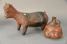 Two red clay pottery pieces including a dog and a vessel with black paint and handle .(dog has crack and repair)  dog: ht. 10 1/2...