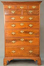 Seven drawer Chippendale walnut tall chest with large cornice molded top over faux three drawers over two short drawers over five dr...