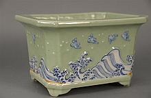 Celadon planter, rectangular, decorated with waves and birds.Rht. 7 1/2 in.; wd. 12 in.; dp. 10 in.