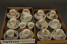 Group of twelve Shelley cups and saucers along with a creamer, sugar, and tray.
