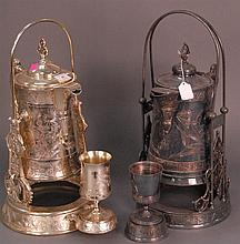Two silverplate tilting pots with cups, one mounted with birds, ht. 19 1/2in.