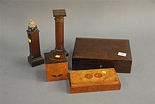Group lot to include Benson and Hedges humidor, inlaid alphabet cube, burl cigar box, and two columns.