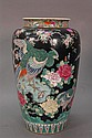 Large Famille Verte phoenix bird vase with painted birds amongst blossoming wild flowers with red mark on bottom. ht. 17in.