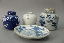 Four pieces of Chinese blue and white and Canton to include three ginger jars and a phoenix plate.