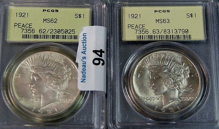Two silver dollars; 1921 peace dollar PCGS 62 and 1921 peace dollar PCGS 63.