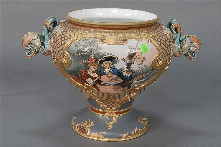 Mettlach punch bowl with scene of men and women with a punch bowl and two dolphin handles, each dolphin with slight chip repair, mar...