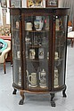 "Oak bowed glass china cabinet with claw feet, ht. 63"" wd. 38""."