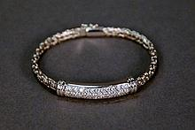18K white gold bracelet set with pave of diamonds. lg. 7in.