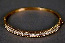 14K gold bangle style bracelet set with thirty three diamonds. 14.4 grams; 2 1/4