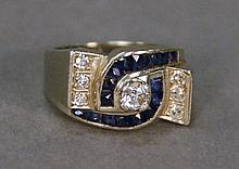 18K white gold ring set with diamonds and sapphires. size 6 1/4; 10.6 grams