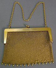 14K gold mesh evening bag with chain and gold bead decorated bottom, marked with a C in a fish. 120.5 grams; 4