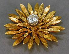 14K gold brush design sunflower pin set with center diamond approximately 1.15 cts marked with R on back. 15.3 grams; dia. 1 1/2in.