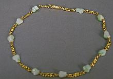 18K gold chain with white jade stones. total weight 24.5 grams; lg. 16in.