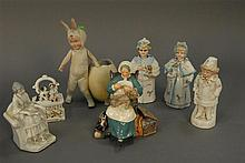 Group of porcelain figures to include pair of German porcelain nodders, dresser box, Heubach bunny with egg, and Royal Doulton Nanny...