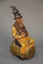 Royal Doulton Kingsware figural flask of man on barrel with original stopper