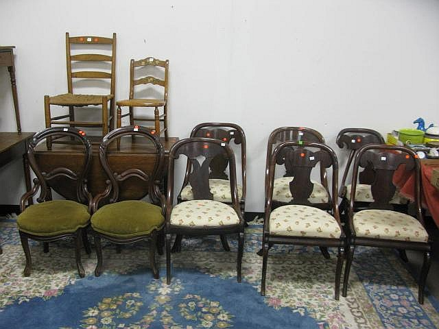 Group of ten chairs and drop leaf table including
