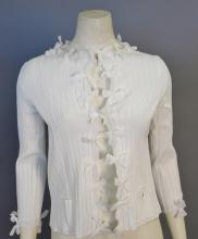 Chanel white cardigan with bow accents, new with tags retail $1,790
