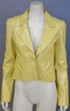 Chanel yellow short jacket, calfskin/leather with silk lining, new with tags.