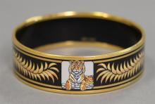 Hermes enameled bangle bracelet with crowns and tigers marked Hermes Paris.