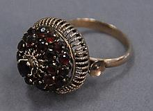 14K gold ring set with garnets.