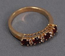 18K gold ring set with four rubies and six diamonds.
