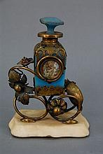 Blue opaline glass bottle with ormolu brass mount, round scenic plaque, and jeweled flowers all on marble base. ht. 6 1/2in.