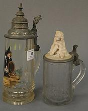 Two glass beer steins, one with hand painted girl and cat ht. 10 1/2in. and one with Bisque figural top etched 1850 ht. 7 1/2in.