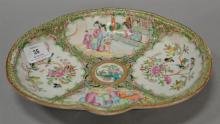 Famille Rose shaped deep dish with four panels, late 19th century. ht. 1 1/2 in.; lg. 10 3/4 in.; wd. 8 1/2 in.