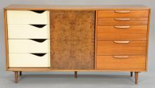Harvey Probber credenza with burled sliding doors and bank of five exterior drawers having four interior drawers and three shelves, ...
