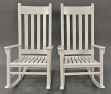 Pair of white porch rockers.