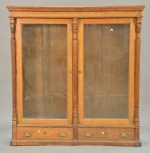 Victorian oak two door bookcase with two drawer base. ht. 65 1/2 in.; wd. 62 1/2 in.