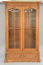 Victorian walnut and burl walnut two door bookcase with two drawer base. ht. 95 in.; wd. 56 in.; dp. 19 1/2 in.
