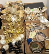 Four box lots of silverplate, cups, serving pieces, ebony peper grinders, brass push up candlesticks, pair of brass candlesticks, etc.