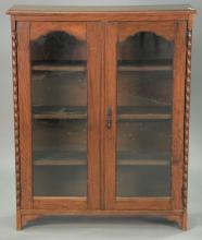 Oak two door bookcase. ht. 43