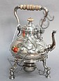 Crichton silver hot water pot on tilting stand with family crest on one side, wood swing handle, and wood finial with spout in form ...