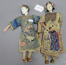 Two Chinese dolls with white painted faces and embroidered robes.Rht. 10 1/4 in.