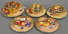 Three Royal Worcester hand painted fruit demitasse cups with saucers (dia. 3 1/2 in.) along with two additional saucers.