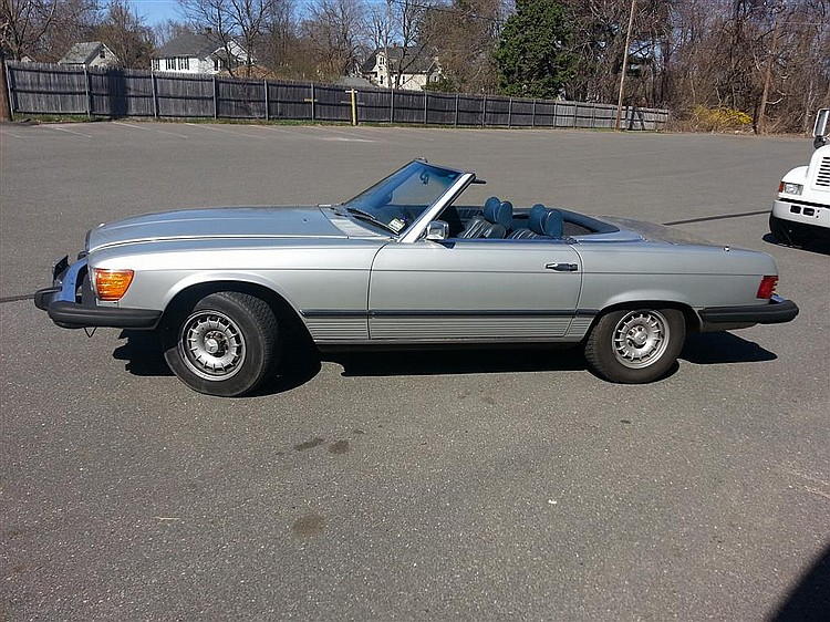 1975 Mercedes 450 SL, silver with navy blue interior having removable top, 132K miles, two owners.