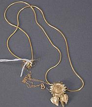Lot of 14K gold to include floral pendant and two chains including one fine chain, 8.6 grams.