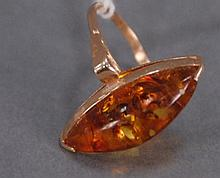 Foreign gold ring with amber stone.