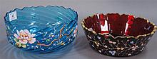 Two bowls with enamel decoration, one cranberry ht. 3in.; dia. 9in. and one blue ht. 4in.; dia. 9in.