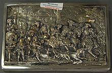 Silver embossed plaque of Continental scene with knights, horses, peasants, and dogs marked HW 999 with crown and lion.