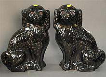Pair of black earthenware dogs, ht. 14in.