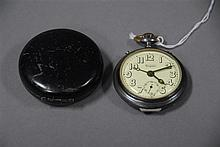 Daynite alarm pocket watch open face in a case.